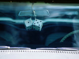 Ornamental Dice Hanging from the Rear Vision Mirror of a Classic Car on Route 66, Arizona, USA Photographic Print by Ray Laskowitz