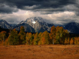 Storm Clouds Over Mountains and Trees, Grand Teton National Park, USA Photographic Print by Carol Polich