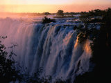 Victoria Falls at Sunset from Zambia, Victoria Falls, Zambia Fotografisk tryk af Dennis Johnson