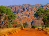 Natural Rock Formations of Bungle Bungles and Dirt Road Leading to It, Purnululu NP, Australia Photographic Print by John Banagan