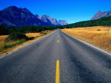 Road with Mountain Range in Distance Glacier National Park, Montana, USA Photographic Print by Rob Blakers