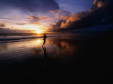 Man Jogging on Seminyak Beach at Sunset Seminyak, Bali, Indonesia Photographic Print by John Borthwick
