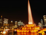 Gold Lights of Buckingham Fountain in Grant Park with City Skyline in Background, Chicago, USA Photographic Print by Charles Cook