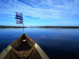 Bow of Boat with Flag Rovaniemi, Lapland, Finland Photographic Print by John Borthwick