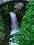 Christine Falls Through the Arch of a Stone Bridge, Mt. Rainier National Park, USA Fotografiskt tryck av Brent Winebrenner