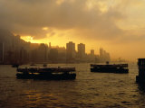 Ferries Silhouetted on the Harbour at Sunset, Hong Kong Photographic Print by Richard I'Anson