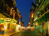 Flags Hanging Over the Empty Bourbon Street at Night, New Orleans, Louisiana, USA Lmina fotogrfica por Richard Cummins