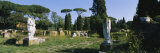 Ruins of Statues in a Garden, Ostia Antica, Rome, Italy Photographic Print by  Panoramic Images