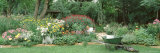 Mature Man Working in a Garden, Hinsdale, Illinois, USA Lámina fotográfica por Panoramic Images,