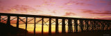 Silhouette of a Railway Bridge, Fort Bragg, California, USA Photographic Print by  Panoramic Images