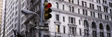 Traffic Light in Front of a Building, Wall Street, New York, USA Fotografie-Druck von Panoramic Images