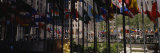Flags in a Row, Rockefeller Plaza, Manhattan, New York, USA Photographic Print by  Panoramic Images