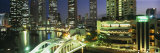 Buildings Lit Up at Night, Singapore Photographic Print by  Panoramic Images