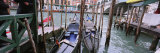 Gondolas Moored near a Bridge, Rialto Bridge, Grand Canal, Venice, Italy Photographic Print by  Panoramic Images