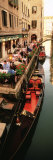 Gondolas Moored Outside of a Cafe, Venice, Italy Fotografisk tryk af Panoramic Images,
