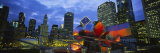 Buildings Lit Up at Night, Millennium Park, Chicago, Illinois, USA Fotografisk tryk af Panoramic Images