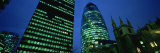 Buildings Lit Up at Night, Sir Norman Foster Building, Swiss Re Tower, London, England Photographic Print by  Panoramic Images
