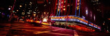 Buildings Lit Up at Night, Radio City Music Hall, Rockefeller Center, Manhattan, New York, USA Photographic Print by  Panoramic Images