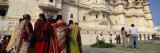 Tourists Standing near a Palace, Udaipur City Palace, Udaipur, Rajasthan, India Photographic Print by  Panoramic Images
