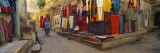 Market Vendor Sitting at a Market Stall, Jaisalmer, Rajasthan, India Photographic Print by  Panoramic Images