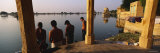 Four Men Standing at the Lakeside, Gadi Sagar Gate, Jaisalmer, Rajasthan, India Photographic Print by  Panoramic Images