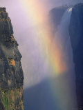 Victoria Falls with Rainbow in Spray, Zimbabwe Premium Photographic Print by Pete Oxford
