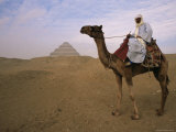 Bedouin Camel Rider in Front of Pyramid of Djoser, Egypt, North Africa Photographic Print by Staffan Widstrand