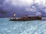 Bajau Fisherman in Traditional Lepa Boat with Rain Clouds Behind, Pulau Gaya, Borneo, Malaysia Posters by Jurgen Freund