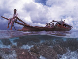 Bajau Fisherman on Lepa Boat in Shallow Water Over Coral Reef, Pulau Gaya, Borneo, Malaysia Posters by Jurgen Freund