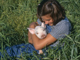Girl Holding Domestic Piglet, Mixed Breed, USA Photo by Lynn M. Stone