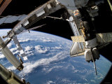 The Docked Space Shuttle Atlantis (STS-115) and a Soyuz Spacecraft Photographic Print by Stocktrek Images
