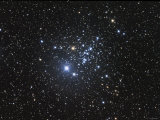 NGC 457 is an Open Star Cluster in the Constellation Cassiopeia Lámina fotográfica por Stocktrek Images