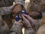Marines Fold an American Flag after It was Raised in Memory of a Fallen Soldier Photographic Print by  Stocktrek Images