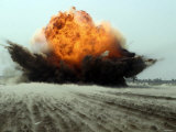 An Explosion Erupts from the Detonation of a Weapons Cache Photographic Print by Stocktrek Images