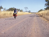 Lone Cyclist on Country Road, Western Australia, Australia Photographic Print by Richard Ashworth