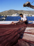Fisherman Mending Nets on Quayside at Katapola, Island of Amorgos, Cyclades, Greece Photographic Print by Richard Ashworth