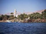Youths Swimming from Jetty, Town Beach, Aqaba, Jordan, Middle East Photographic Print by Richard Ashworth