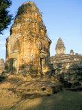 Tower at West and in Background the Central Shrine of the Bakong Temple Photographic Print by Richard Ashworth