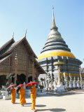 Novice Monks and Wat Phra That Lampang Luang, Northern Thailand, Southeast Asia Photographic Print by Richard Ashworth
