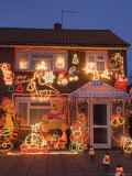 Suburban House with Christmas Lights and Decorations, Surrey, England, United Kingdom Photographic Print by Charles Bowman