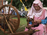 Woman in Traditional Costume Demonstrating Authentic Spinning, Witham Medieval Fayre, Essex Photographic Print by Jeremy Bright