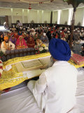 Sikh Priest and Holy Book at Sikh Wedding, London, England, United Kingdom Fotografie-Druck von Charles Bowman