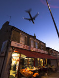 Aeroplane Above Shop, Hounslow, Greater London, England, United Kingdom Photographic Print by Charles Bowman