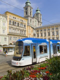 Tram and Old Cathedral, Hauptplatz, Linz, Austria Photographic Print by Charles Bowman
