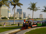 Train in the Park, and Sharjah Creek Skyline, Sharjah, United Arab Emirates, Middle East Photographic Print by Charles Bowman