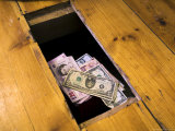 Money Beneath the Floorboards Photographic Print by Charles Bowman