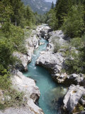 Soca River with Clear Emerald Water Flowing Between Eroded Rocks in Trenta Valley in Summer Photographic Print by Pearl Bucknall