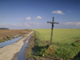 Christian Calvary Beside Muddy Track and Fields in Landscape Near Agincourt, France Photographic Print by Michael Busselle