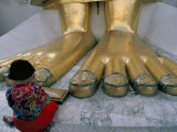 Woman Praying at the Feet of the Buddha in the Temple of the Standing Buddha Photographic Print by Bruno Barbier