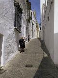 Village Street, Arcos De La Frontera, Cadiz, Andalucia, Spain Photographic Print by Michael Busselle